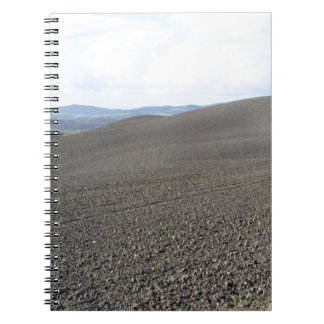 Winter Tuscany landscape with plowed fields Notebook