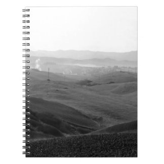 Winter Tuscany landscape with plowed fields Notebooks