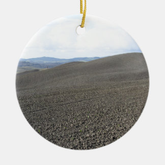 Winter Tuscany landscape with plowed fields Round Ceramic Ornament