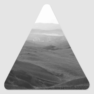 Winter Tuscany landscape with plowed fields Triangle Sticker