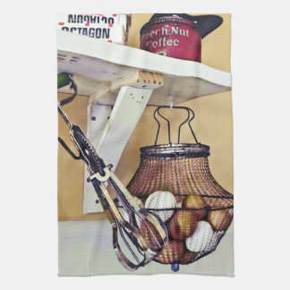 Wire Basket Of Eggs And Egg Beater Kitchen Towel