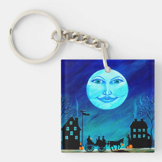 Witch moon and horse and carriage key chain