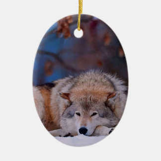 Wolf Hunts In The Snow Ceramic Oval Ornament