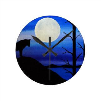 wolf on the mountain round clock