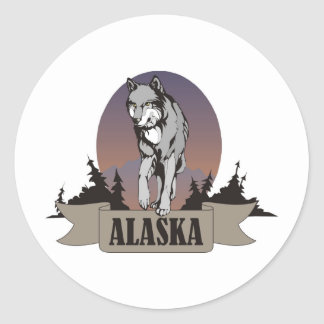 Wolf or coyote among pine trees in Alaska Round Sticker