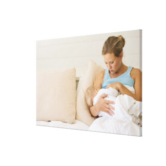 Woman breastfeeding baby canvas print