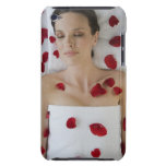 Woman ed in flower petals laying on massage Case-Mate iPod touch case