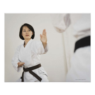 Woman fighting in karate competition poster