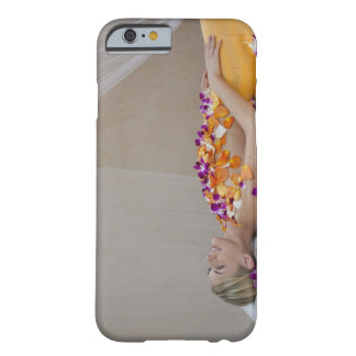 Woman getting a flower treatment at a spa. barely there iPhone 6 case
