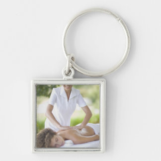 Woman getting a massage Silver-Colored square keychain