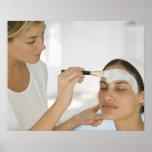 Woman getting beauty mud mask