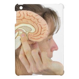 Woman holding hemisphere model  against head iPad mini cover