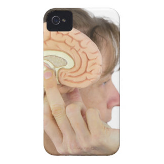 Woman holding hemisphere model  against head iPhone 4 cases