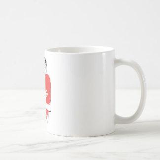 Woman hugging a red heart coffee mugs