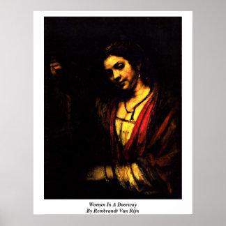 Woman In A Doorway By Rembrandt Van Rijn Posters