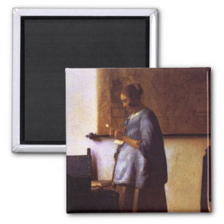 Woman in Blue Reading a Letter Magnet