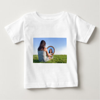 Woman in nature viewing her mirror image baby T-Shirt