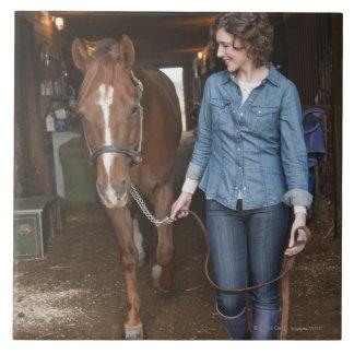 Woman leading horse ceramic tiles