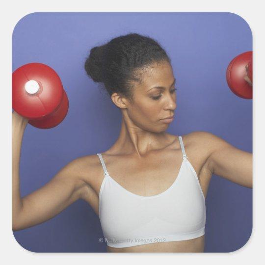 Woman lifting dumbbells 3 square sticker