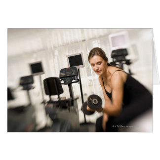 Woman lifting weights in gym 2 card