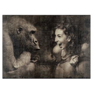Woman Making Gorilla Laugh Cutting Board