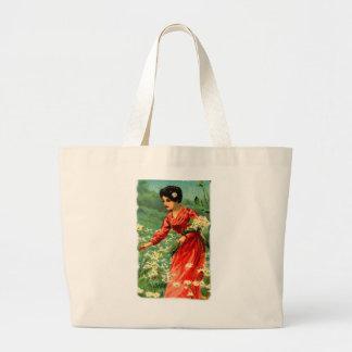 Woman picking flowers large tote bag