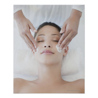 Woman receiving facial massage poster