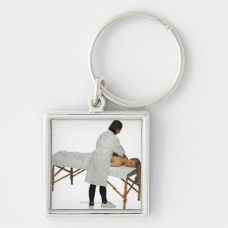 Woman receiving massage 2 key chain