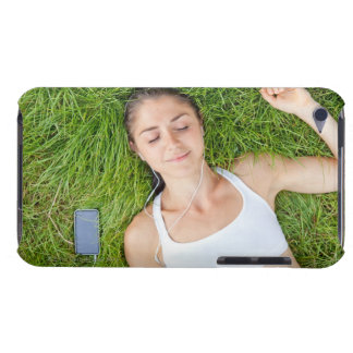 Woman relaxes with music in soft grass barely there iPod covers