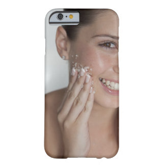 Woman scrubbing sugar on her face barely there iPhone 6 case