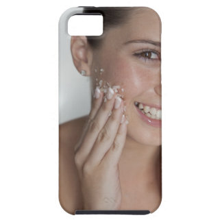 Woman scrubbing sugar on her face iPhone 5 covers