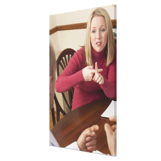 Woman signing the word 'Rent' in American Sign Canvas Print
