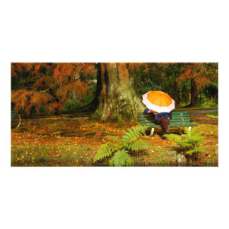 Woman siting with umbrella picture card