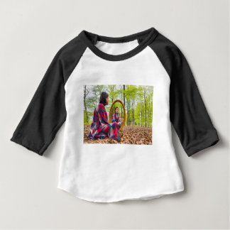 Woman sits with mirror in forest during spring baby T-Shirt