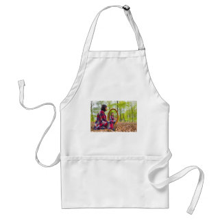 Woman sits with mirror in forest during spring standard apron