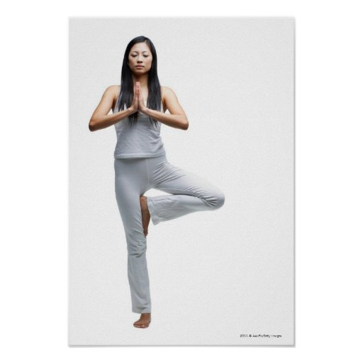 Woman standing in yoga position poster