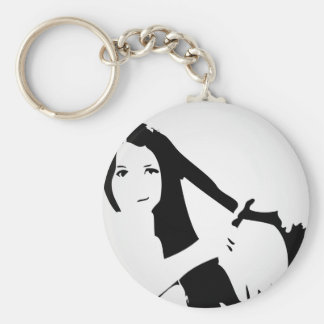 Woman using flat iron on hair basic round button keychain