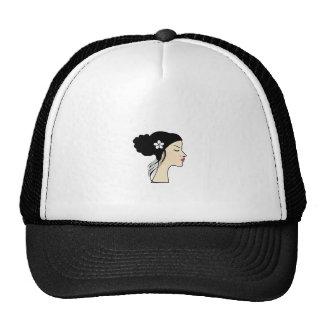 woman with a bun trucker hat