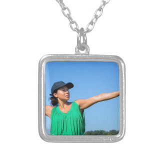 Woman with glove and cap throwing baseball outside silver plated necklace