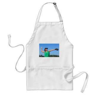 Woman with glove and cap throwing baseball outside standard apron