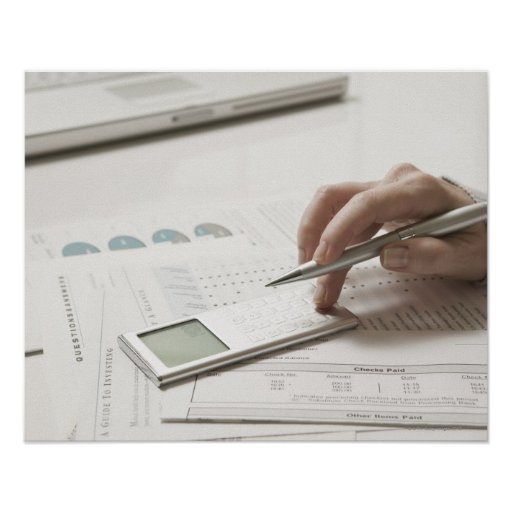 Woman working on financial paperwork and print