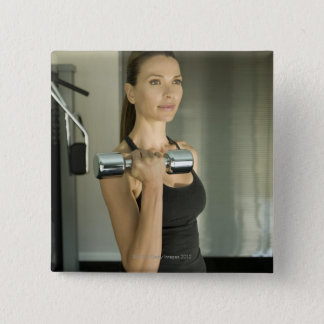 Woman working out in a gym 2 2 inch square button