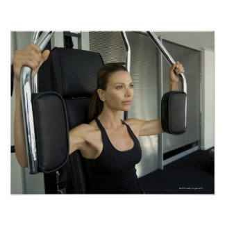 Woman working out in a gym poster