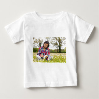 Woman writing in meadow with spring flowers baby T-Shirt