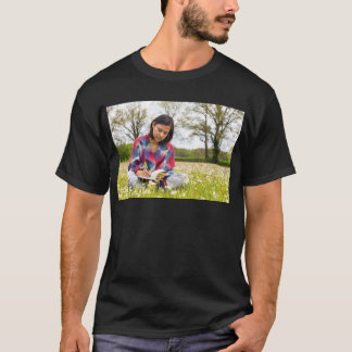 Woman writing in meadow with spring flowers T-Shirt