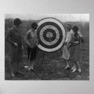 Women examining Archery Target Photograph Poster