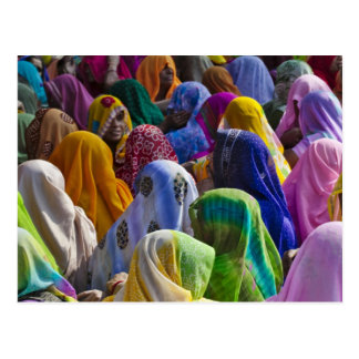 Women in colorful saris gather together postcard