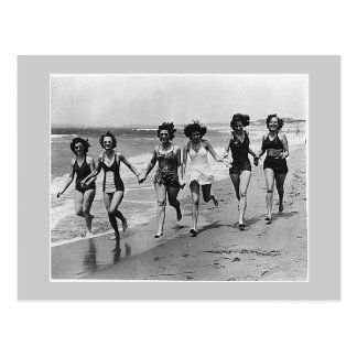 Women run on the beach, 1940s postcard