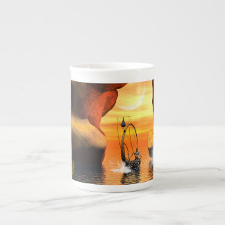 Wonderful seascape with rock and lamp boat tea cup
