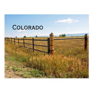 wood and metal fence by prairie postcard